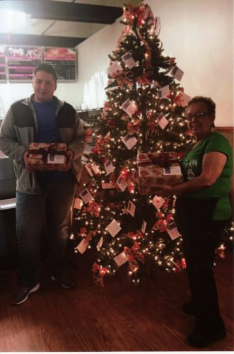 Justin DeVore and Virginia Carpenter are shown with some of the already donated gifts. -- Contributed