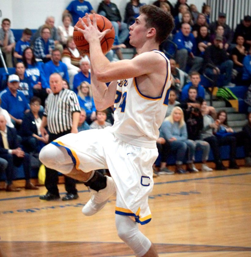 TAKING A SHOT — Catholic Central's Matt Kilonsky pulls up to take a shot during Tuesday's game against East Liverpool. (Photo by Andrew Grimm)
