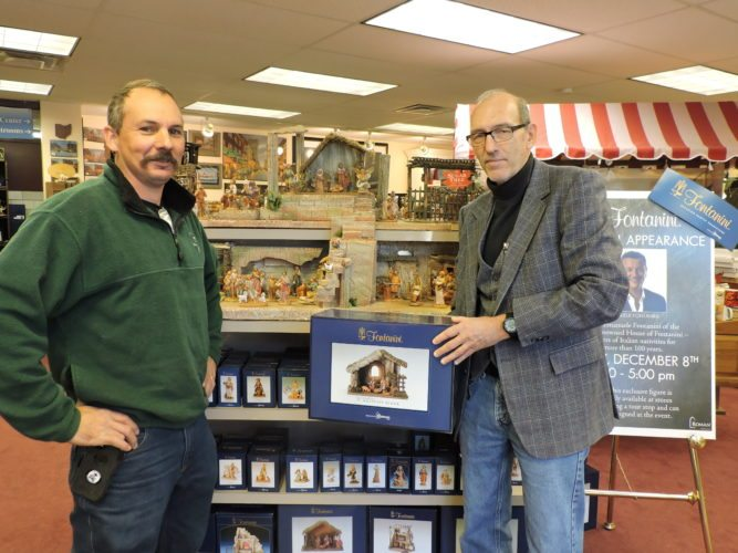 A FONTANINI VISIT — Mark Nelson, left, and Kevin Jordan, retail store manager for Nelson Fine Art, stand in front of a display of Fontanini Heirloom Nativity items that are on sale at the Lincoln Avenue store. Emanuele Fontanini will make an appearance at Nelson's from 3 p.m. to 5 p.m. Friday to sign Fontanini-crafted items.  -- Dave Gossett