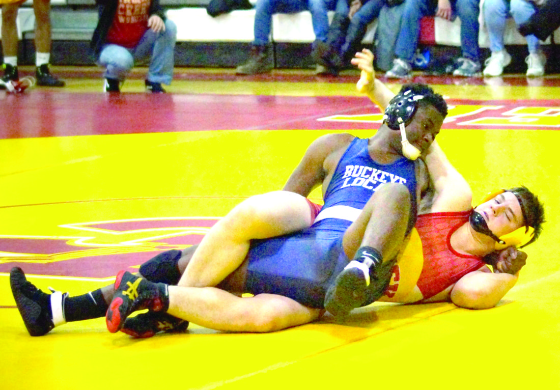 PINNING PREDICAMENT — Buckeye Local's Shayne Christian and Indian Creek's Logan Wilson wrestle in a 182-pound match on Wednesday. Wilson won by pinfall.  -- Andrew Grimm