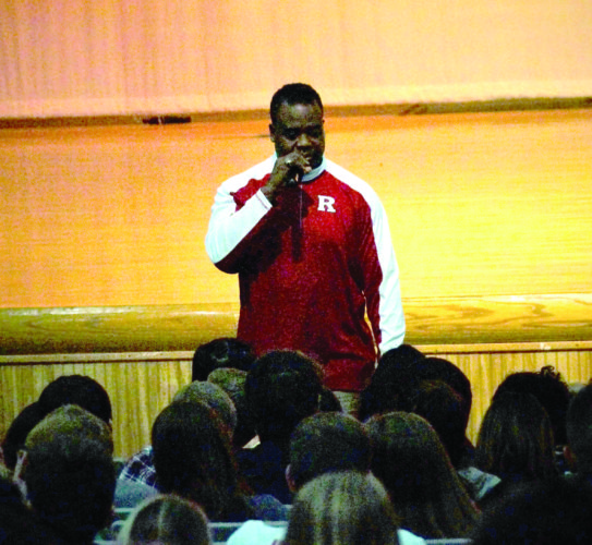 ROUSING OVATION — Former NFL player Lee Rouson speaks to students at Buckeye Local High School on Wednesday.  -- Andrew Grimm