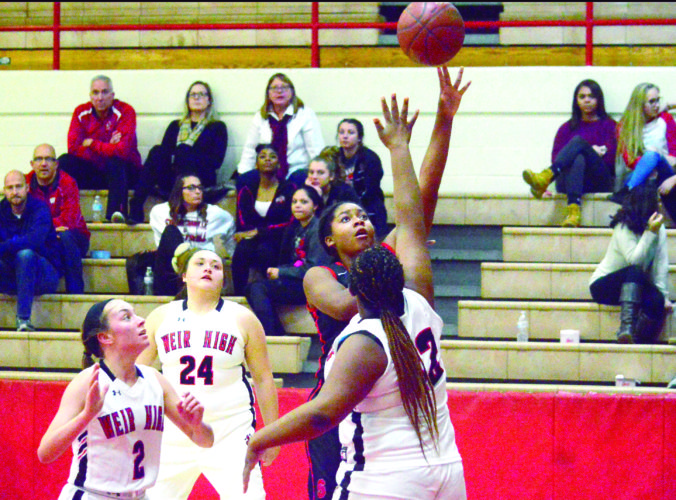 UP AND OVER — Steubenville's Anaiya Minniefield shoots over Weir High's Trezure Elmore-Sarter while Bailey Stead (24) and Sophia Mikula (2) watch on Thursday. (Photo by Joe Catullo)