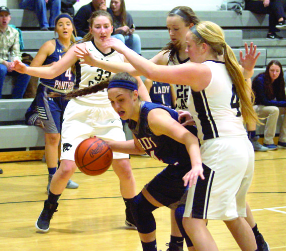 MANEUVERING AROUND — Buckeye Local's Emily Holzopfel posts up against Edison's Tommi McConnell (4) and Lauren Ferralli (22) on Thursday. Also shown are Edison's Sami Springer (33) and Buckeye's Angelina Piergallini (4). (Photo by Andrew Grimm)