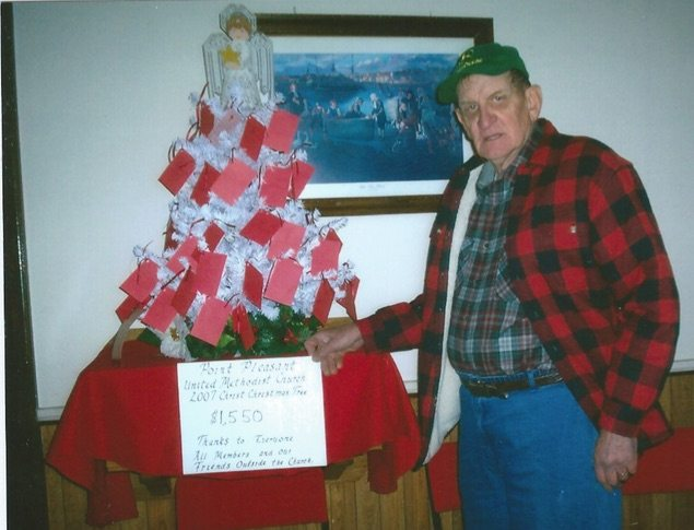 SPECIAL TREE — This 2012 photo shows Bill Glass with the Christ Tree he initiated in 2005 at Point Pleasant United Methodist Church in New Cumberland. since its inception 12 years ago, it has generated more than $27,000 to benefit local charities,  according to a church member. -- Contributed