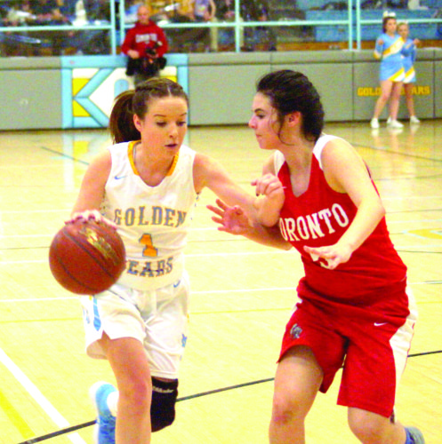 DRIVING DOWN — Oak Glen's Brittney Giorgini dibbles with Toronto's Bianca McDonald guarding Friday. (Photo by Andrew Grimm)