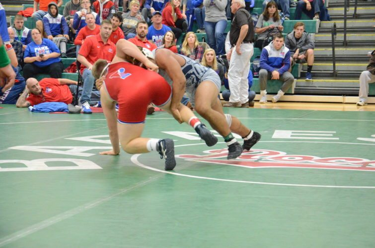 TAKEDOWN — Madonna's Donavan Kirby attempts a takedown against Wheeling Park's Austin Loew in the 195 pound final during Saturday's Doan Ford Invite in Barnesville. Loew won by pin. (Photo by Kim North)