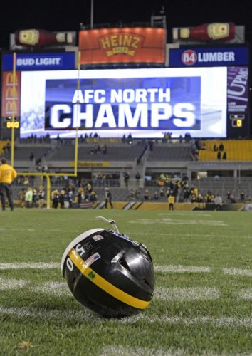 FOR SHAZIER— The helmet of inside linebacker Ryan Shazier  sits on the field early this morning after Sunday's game between the Steelers and Baltimore. The Steelers won one for injured star Shazier and wrapped up the AFC North with a 39-38 win. -- Associated Press