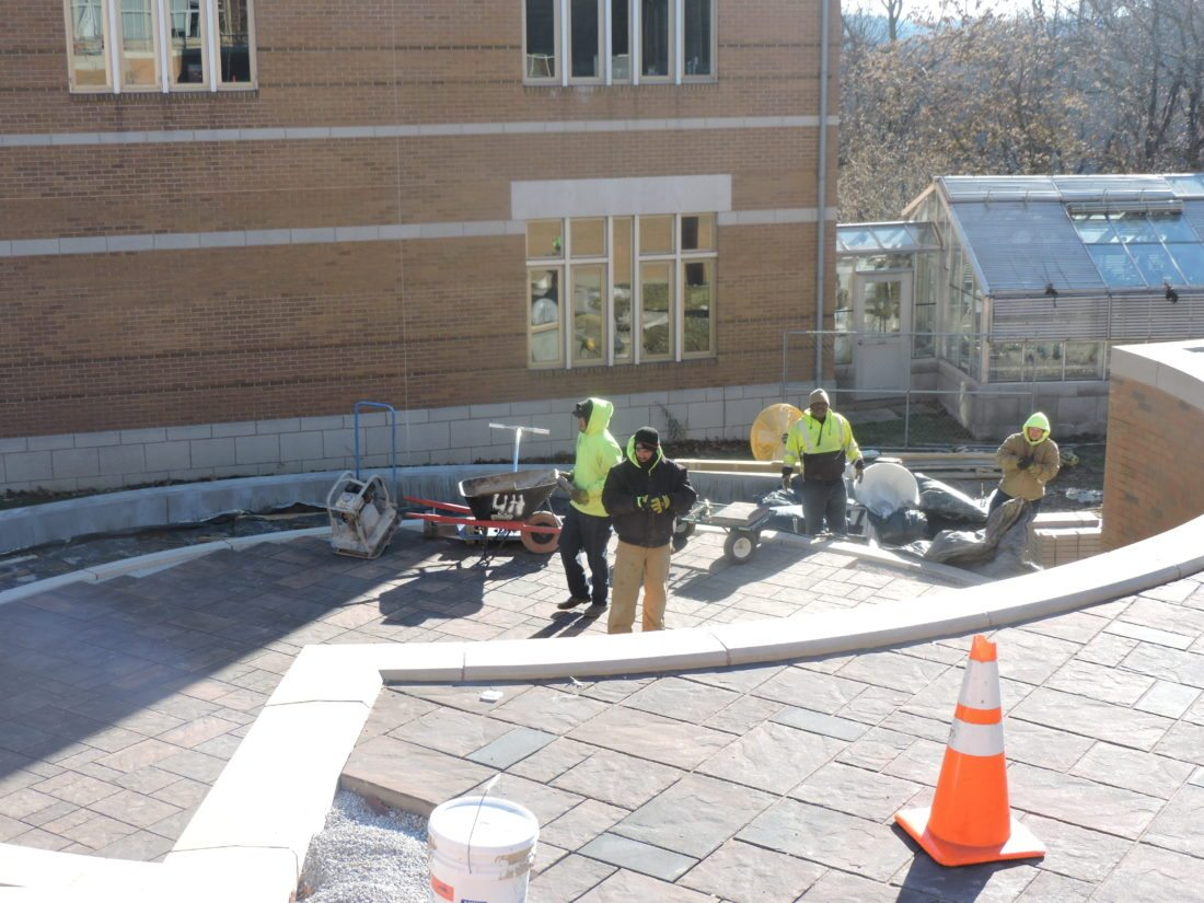 LATEST IMPROVEMENT — Contractors are working to finish the Egan Plaza project by Friday. The $4 million improvement includes new entrances to Egan Hall on the campus of Franciscan University of Steubenville as well as a new five-level interlocking plaza in front of the classroom building. -- Dave Gossett