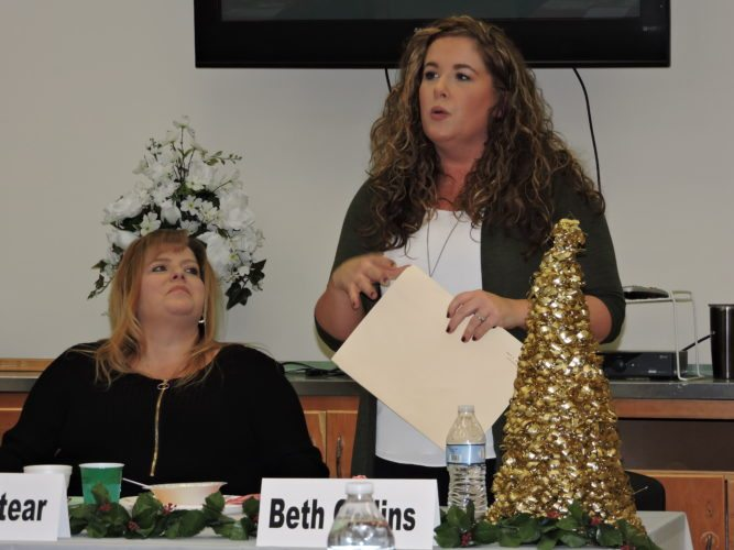 Beth Collins, right, northern regional director for Catholic Charities of West Virginia, discusses some of the services provided locally by the organizations, while Weirton United Way Executive Director Linda Stear listens. The United Way has reached 65 percent of its goal for the 2017 campaign. — Craig Howell
