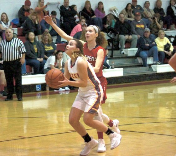 PULLING UP — Indian Creek's Ally Tweedy pulls up to attempt a shot in front of Beaver Local's Emily Monte during the first half of Monday's game at Indian Creek. (Photo by Andrew Grimm)