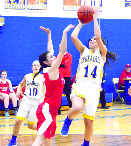 GOING UP — Steubenville Catholic Central's Tia Taglione attempts a shot over Toronto's Bianca McDonald on Wednesday. (Photo by Joe Catullo)