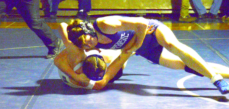 PINNING — Buckeye Local's Skyler Hatten pins Harrison Central's Jacob Delulas in a 152-pound match on Wednesday. (Photo by Kim North)