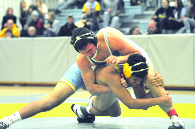 POTTER STRONG — Oak Glen's Kyle O'Connor wrestles with East Liverpool's Nathan Miscuk in a 182-pound match on Wednesday. Miscuk won via pinfall. (Photo by Dan Santarelli)