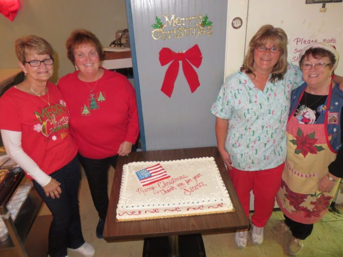 MAKING THE SEASON BRIGHT — Post 33 Ladies Auxiliary members who helped make possible the annual Christmas party for disabled veterans were, from left, Mary DiMichele, treasurer; President Terri Stullenburg, event chair along with Cindy Longwell, historian; and Dorothy Mazik, first vice president. -- Janice Kiaski