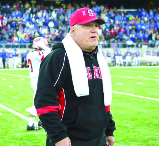 STAYING POSITIVE — Steubenville head coach Reno Saccoccia walks to the sidelines after a timeout during Big Red's Division IV championship game against Clinton-Massie on Dec. 1. (Photo by Michael D. McElwain)