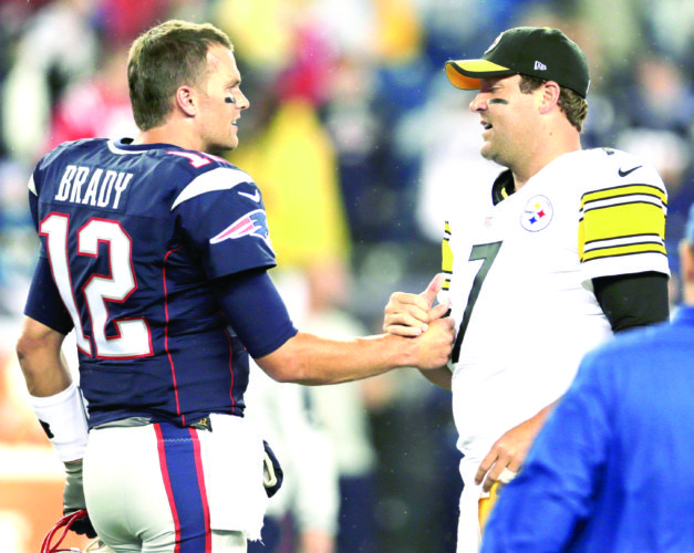 TIME TO SHINE — New England Patriots quarterback Tom Brady speaks with Pittsburgh Steelers quarterback Ben Roethlisberger before a game on Sept. 10, 2015 in Foxborough, Mass. (AP Photo)