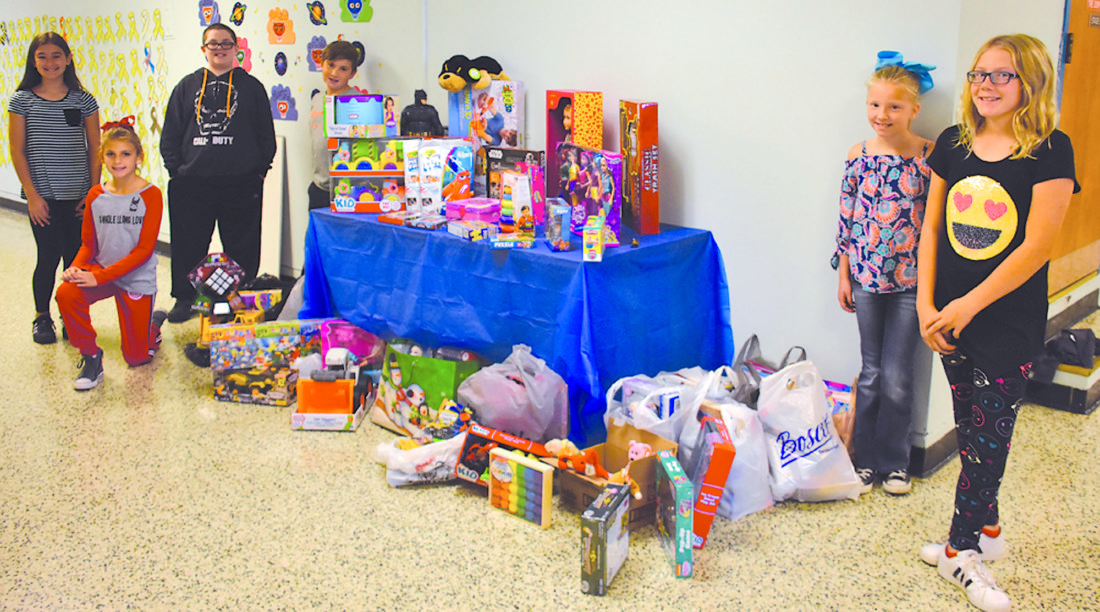 RAISING SPIRITS — Pupils and staff at Follansbee Middle School as well as community members donated 137 toys for the young patients at Pittsburgh Children's Hospital during a collection organized by teacher Kelly Eggert in memory of her brother, Farnkie Biewin, who died of cancer at the age of 12.  -- Contributed