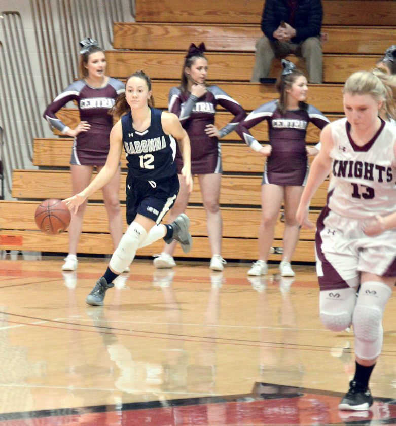 DRIBBLING ON BY — Madonna's Carly Dowiak dribbles against Wheeling Central in the final of the Undo's tournament Saturday at Wheeling Jesuit. (Photo by Kyle Lutz)