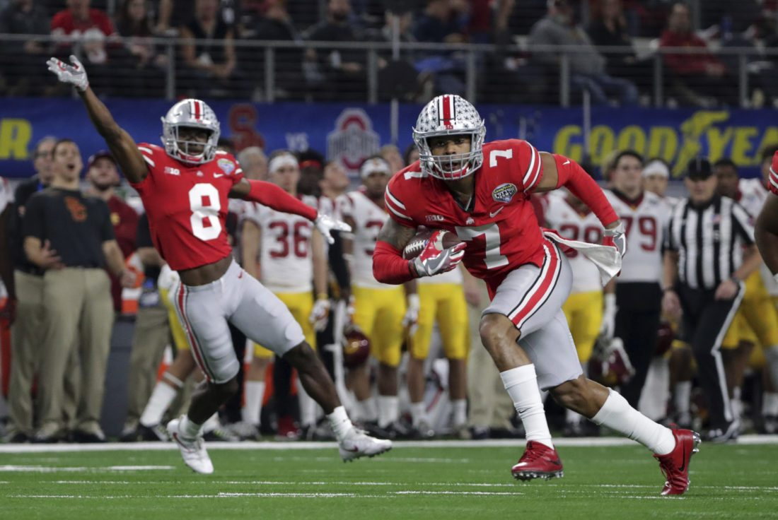 Ohio State safety Damon Webb (7) runs an interception in for a touchdown in front of cornerback Kendall Sheffield (8) during the first half of the Cotton Bowl NCAA college football game against Southern California in Arlington, Texas, Friday, Dec. 29, 2017. (AP Photo/LM Otero)
