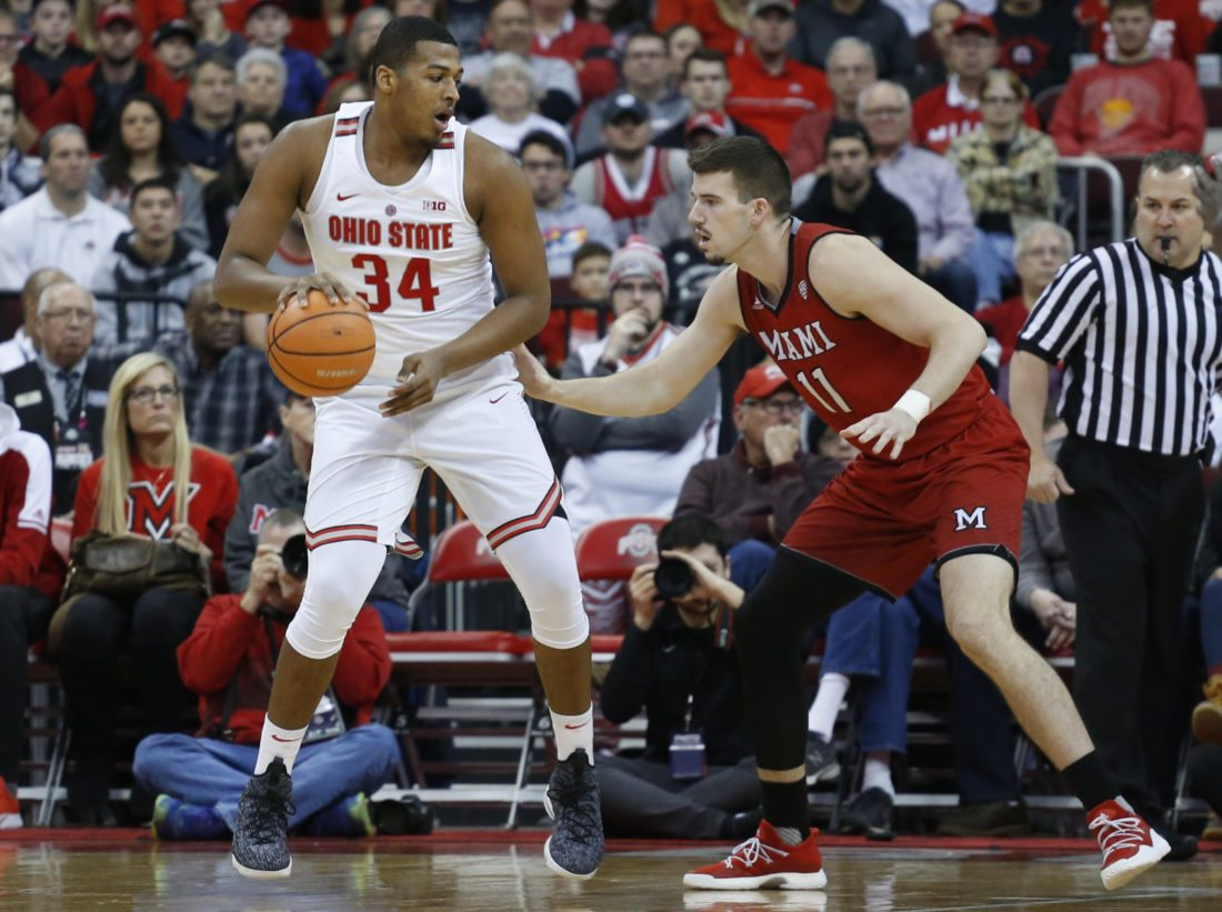 Ohio State's Kaleb Wesson, left, posts up against Miami of Ohio's Logan McLane during the first half of an NCAA college basketball game, Saturday, Dec. 30, 2017, in Columbus, Ohio. (AP Photo/Jay LaPrete)