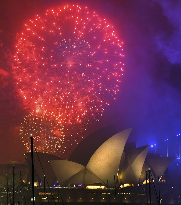 Fireworks dwarf the Sydney Opera House in Sydney Harbor as 2018 arrived today. — Associated Press