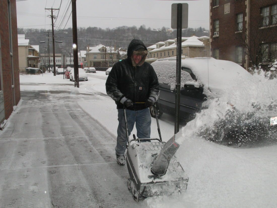 STAYINGWARM — Doctors urge residents to use common sense when dealing with the extremely cold temperatures, which are expected to stick around for another week. Doctors recommend layering clothing and wearing hats and gloves. Local dentist Joseph Clause bundled up this weekend to run a snowblower outside his office at North Fourth and Dock streets -- Mark Law