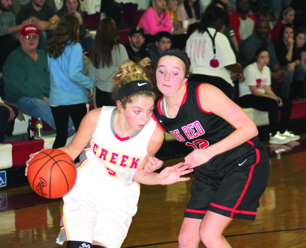 DRIVING BY — Indian Creek's Kylie Kiger dribbles past Steubenville's Sarah Brown on Thursday. (Photo by Joe  Catullo)