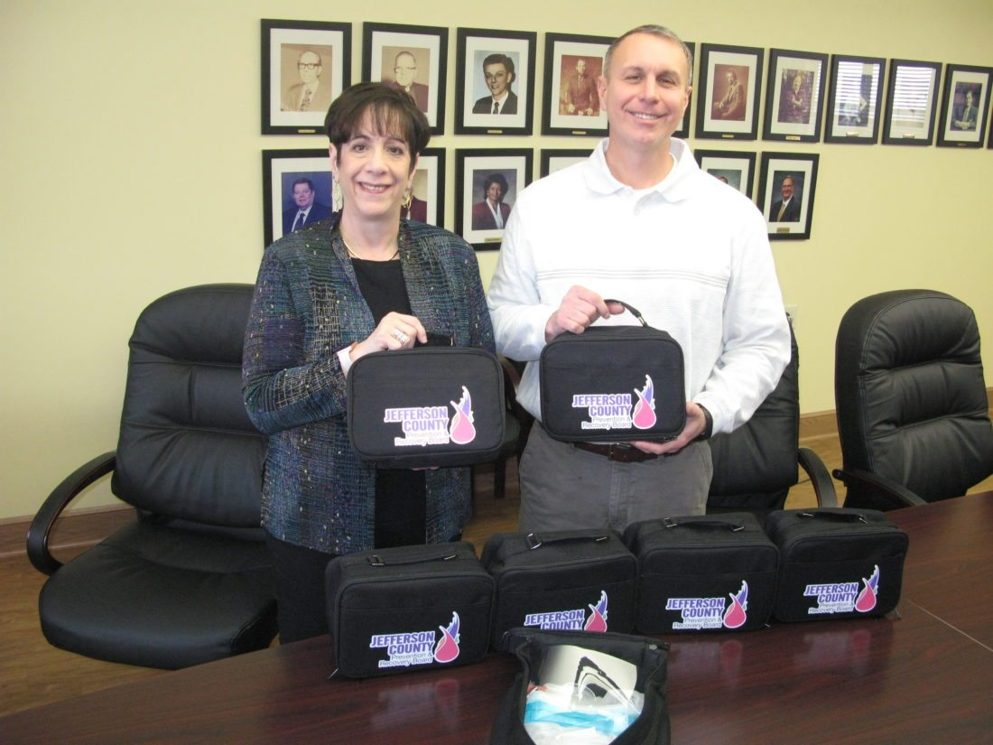 SAFETY KITS — Jefferson County Prevention and Recovery Board members have begun distributing safety kits to local law enforcement agencies to help protect officers and deputies when drugs and needles are involved in an investigation. Showing off some of the kits are Pamela Petrilla, director, and Daniel Obertance, associate director. -- Mark Law