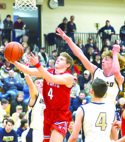 LAYING IT IN — Toronto's Nate Karaffa shoots around United's Dakota Hill (23), Parker Hydrick (4) and Landon Baker (25) on Tuesday. -- Patti Schaeffer