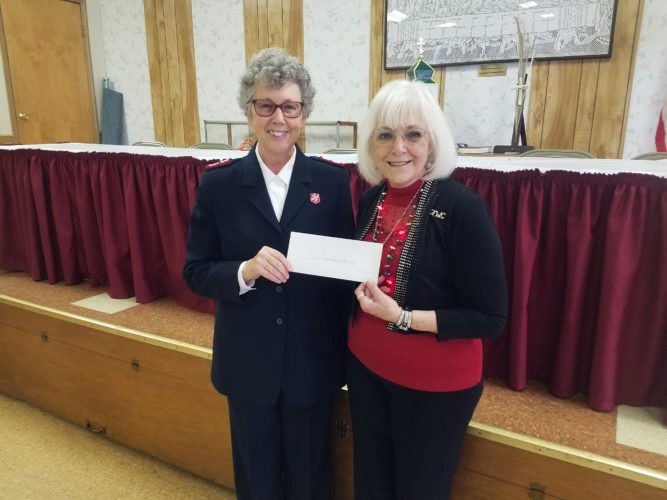 HELPING OUT — Maj. Nettie Morton, left, of the Salvation Army accepts a donation from Diana Durst, president of the Weirton Woman's Club.  -- Contributed