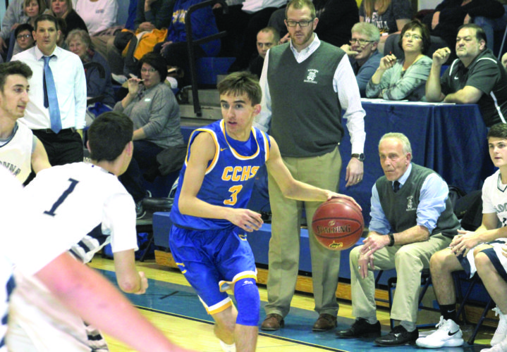 FINDING ROOM — Steubenville Catholic Central's AJ Connor dribbles against Madonna on Friday. (Photo by Joe Catullo)