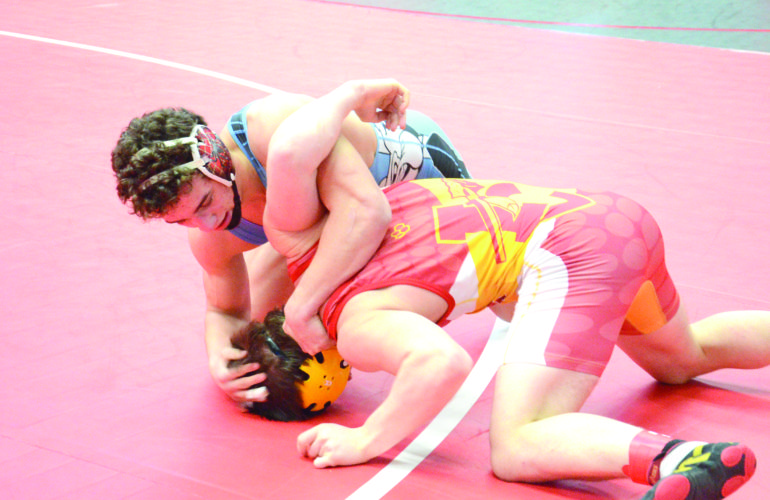 WRESTLING TIME — Bridgeport's Santino Kusic competes with Indian Creek's Logan Wilson in a 170-pound match on Friday. (Photo by Kim North)