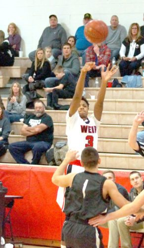 LETTING IT GO — Weir High's Sebastian Spencer attempts to hit a 3-pointer during the first quarter of Tuesday's game with Edison at the Carl R. Hamill Field Hous. (Photo by Andrew Grimm)