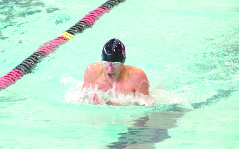 Steubenville's Tanner Power swims in the 100 breaststroke. (Photo by Andrew Grimm)