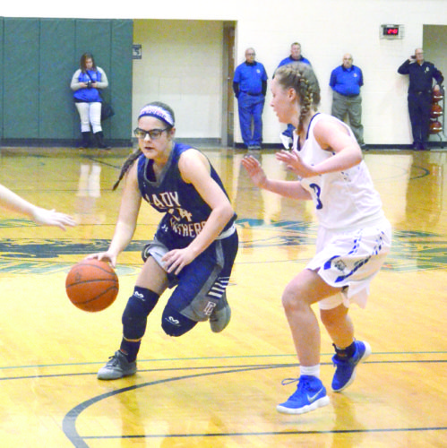 PAINTING — Buckeye Local's Alaire Destifanes dribbles against Cambridge during the OVAC tournament on Saturday. (Photo by Seth Staskey)
