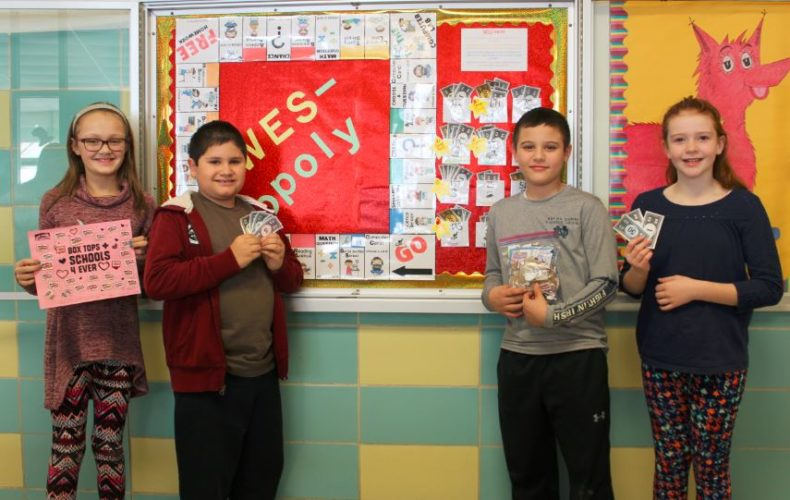 BOX TOPS COLLECTION — Wintersville Elementary School pupils collected 6,115 box tops during a month-long contest to help add more technology to the classrooms. A Monopoly-type game was formed to increase interest and classes earned play money and chances to advance their game pieces by bringing in more contributions. Some of those taking part were, from left, Emma Westfall, Jayden Satkowski, Eli Kuczykowski and Delaney Bates-Dallman.