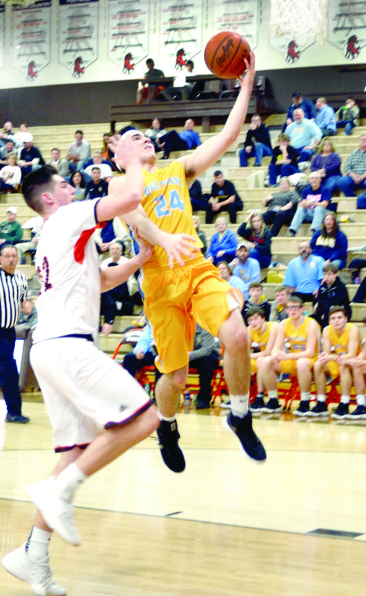 FLYING HIGH — Oak Glen's Marcus Poling attempts a layup past Meadowbrook's Davis Black in an OVAC semifinal on Tuesday. (Photo by Michelle Witt)