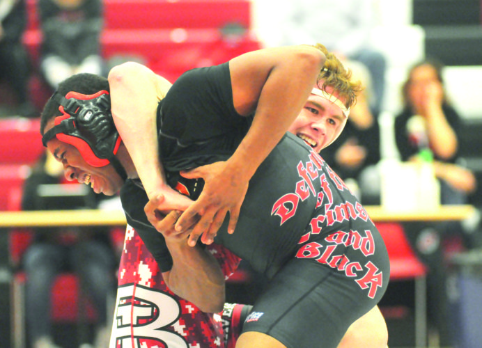 BATTLING — Steubenville's Hezakiah Scurry wrestles against Beaver Local's Chad Mays on Wednesday. (Photo by Dan Santarelli)