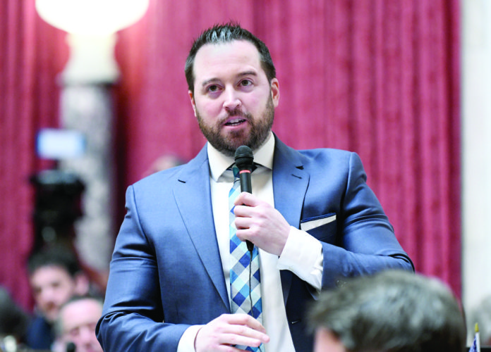 SPEAKING TO THE HOUSE — West Virginia Legislative Services Photo Delegate Shawn Fluharty, D-Ohio, speaks on the floor of the House of Delegates Tuesday at the Capitol in Charleston.