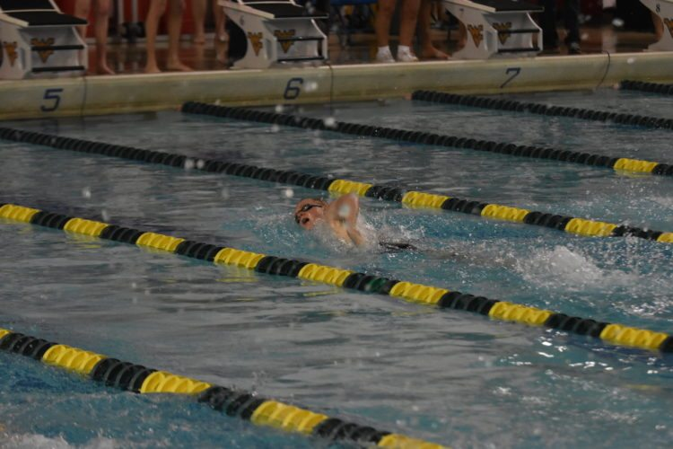 HEADING TO FINALS — Weir High's Wil Visnic competes in the 200 freestyle during Thursday's West Virginia Secondary Schools Activities Commission state swim meet in Morgantown. Visnic is seeded first in the event headed into today's championship finals. -- John McCabe