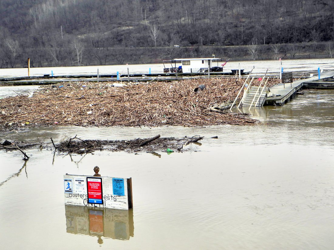 HIGH WATER — The Ohio River washed debris into the boat docks near the Misty River Marina in Toronto Saturday morning. The river didn't rise above the banks there but exceeded flood levels in many other areas of the Ohio Valley. -- Warren Scott