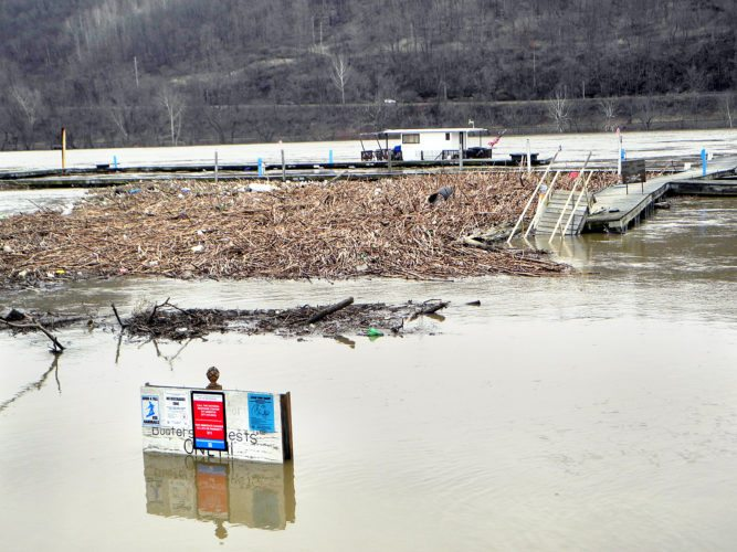 HIGHWATER — The Ohio River washed debris into the boat docks near the Misty River Marina in Toronto Saturday morning. The river didn't rise above the banks there but exceeded flood levels in many other areas of the Ohio Valley. -- Warren Scott
