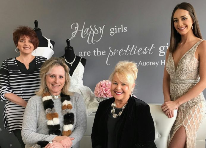 PLANNING EVENT — Working on plans for a Feb. 25 fundraiser to benefit Refuge 1:99 are, from left, Shari Prichard, board chair; Jill Jones, owner J.Jones Evening Wear; Phyllis Riccadonna, event co-chair; and Alex Taylor of WTOV-TV, master of ceremonies. -- Contributed