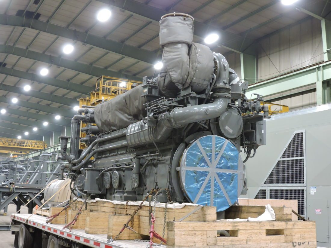 COMPRESSOR MOTOR — The motor for one of the gas compressors being fabricated at Bidell Gas Compression's Weirton facility sits ready for delivery Monday morning. The company shipped out its first unit Monday, following four months of work. -- Craig Howell
