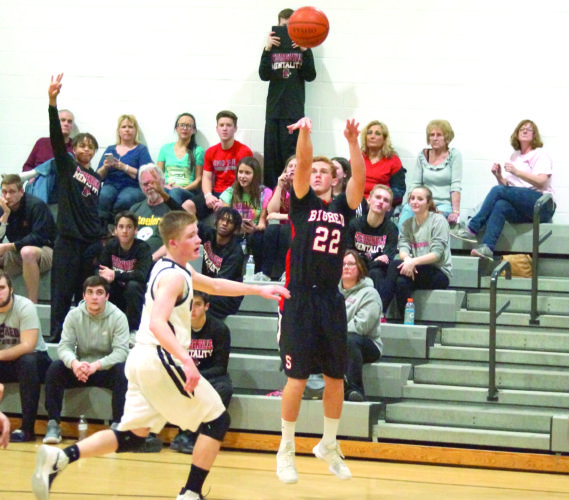 LONG RANGE — Steubenville's Nicco Bracone attempts a 3-pointer over Edison's Alec McBane on Tuesday. (Photo by Andrew Grimm)