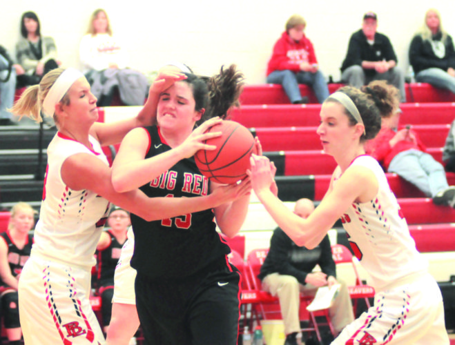 HEAVILY GUARDED — Steubenville's Madison Fields drives to the basket as Beaver Local's Madison Cline (left) and Emily Monte defend in a sectional contest Wednesday. (Photo by Dan Santarelli)