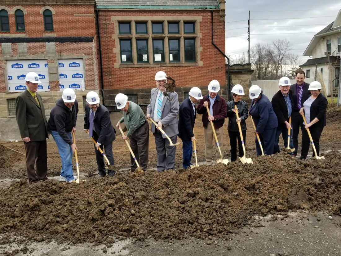 GROUND BROKEN —   The Public Library of Steubenville and Jefferson County held a formal groundbreaking ceremony for a 10,000-square-foot addition to the main library Wednesday. Participating were, from left, library Assistant Director Mike Gray; Bob DiBenedetto, library building and grounds supervisor; Architect Dan Engen of VEBH Architects of Pittsburgh; library Trustee Stan Gaston; library Director Alan Hall; Mayor Jerry Barilla; library trustees Gary Hallock, Ginny Mascio, Lydia Spragin, Paul Brandt; Architect Adam Cummins of VEBH; and library Fiscal Officer Nikki Magary. -- Paul Giannamore