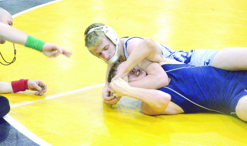 GETTING AHEAD — Madonna's Alec Cook competes in the state tournament on Thursday. (Photo by Kim North)
