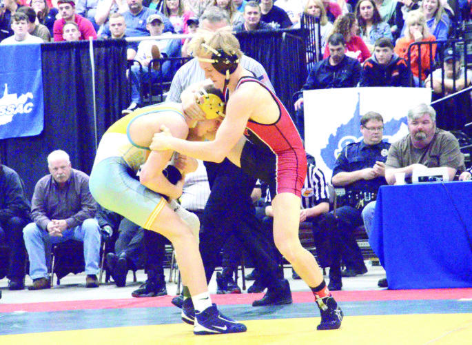 BATTLING IT OUT — Oak Glen's Peyton Hall and Weir High's Caleb Rea compete during the WV Class AA/A state tournament Saturday. (Photo by Kim North)