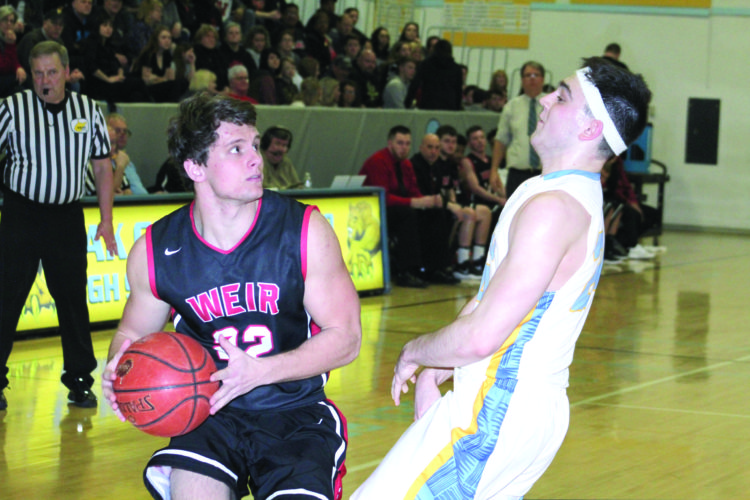 DRIVING IN — Weir High's Jake McCoy looks to shoot over Oak Glen's Marcus Poling during a sectional play-in on Saturday. (Photo by Joe Catullo)